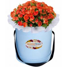 Orange spray roses in a hat box
