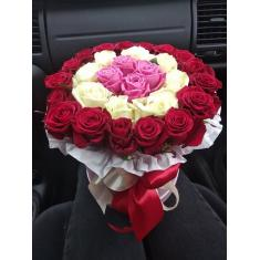 Colored roses in a hat box