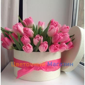 Pink tulips in a hat box